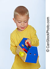 boy with toy toolbox
