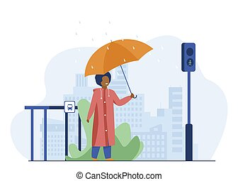 Boy with umbrella crossing road in rainy day