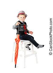 Boy with umbrella studio shot isolated on a white background