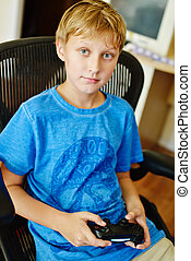 boy with video game controller
