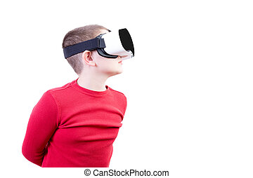 Boy with virtual reality glasses peers left