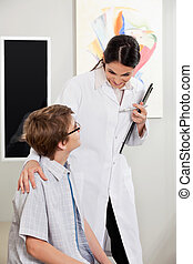 Boy With Vision Problems Consulting To Optometrist