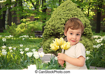 boy with yellow tulips in park, collage