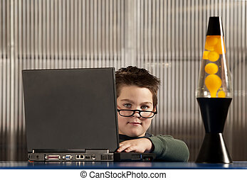 Boy working on a laptop computer