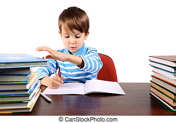 boy writes and takes a book at the same time