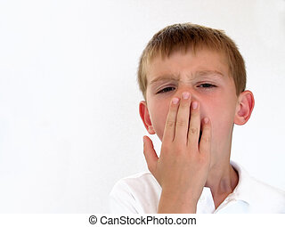 boy yawning - boy covering his mouth while yawning