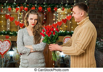 boy giving flowers to his girl