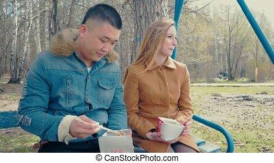 Boyfriend and Girlfriend Eating Asian Food