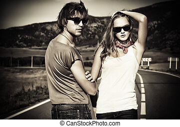 boyfriend - Couple of modern young people posing on a road...