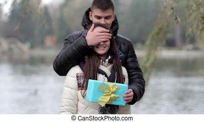 boyfriend gives a girl a gift