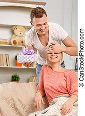 Boyfriend giving present to his girlfriend