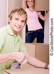 boyfriend helping girlfriend move in