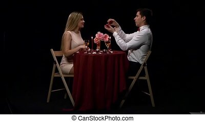 Boyfriend requesting hand of his girlfriend with a engagement ring. Slow motion