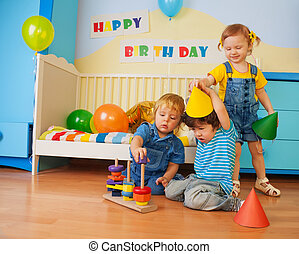 Boys and girl playing on birthday party