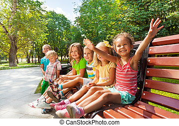 Boys and girls on the bench in park