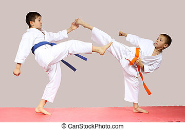 Boys are beating kicks on the mats