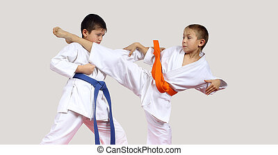 Boys are hitting blows arm and leg