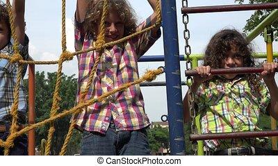 Boys Climbing Ropes at Playground
