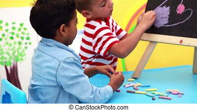 Boys drawing on mini chalkboard - Cute little boys drawing...