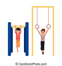 Boys hanging on gymnastic rings and monkey bars at playground