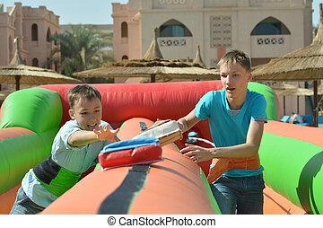 Boys having fun in park