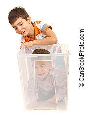 Boys having fun with a box