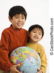 Boys holding globe