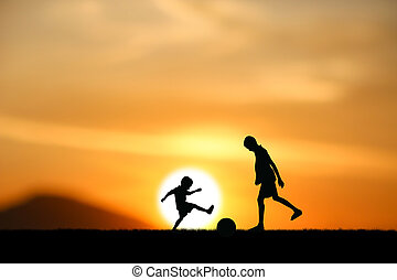 boys jumping - silhouette two brothers, boys play football ...