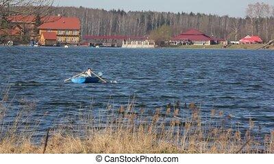 boys oars in boat on river - two boys oars in boat on river,...