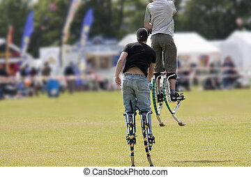 boys on stilts - boys playing on the modern equivalent of...