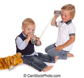 Boys on the phone - Two little brothers talking on the phone...