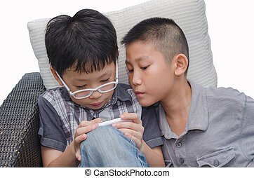 boys play game on phone