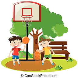 Boys playing basketball in the park