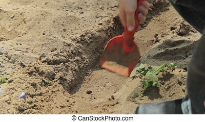 Boys playing in sandbox in kindergarden