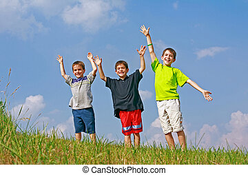 Boys Playing on a Hill