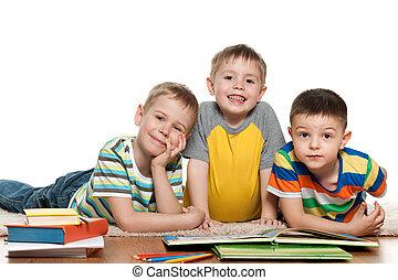 Boys reading on the floor