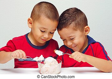 Boys ready to eat ice cream - Two brothers aged five and six...