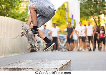 Boys skateboarding on street. Urban life. - Young ...