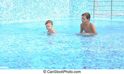 boys swimming in the pool at the resort