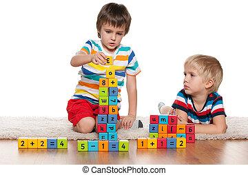 Boys with blocks on the floor