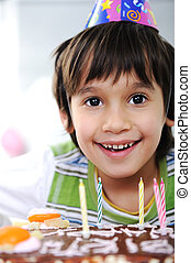 Boys with candles on cake, happy birthday party