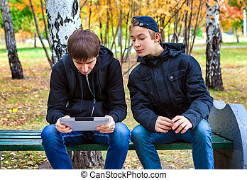 Boys with Tablet outdoor - Boys with Tablet Computer in the...
