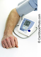 Readings from a self checkup blood pressure machine are displayed digitally.