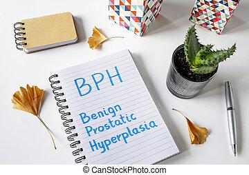 BPH Benign Prostatic Hyperplasia written in a notebook on...