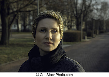 portrait of a young woman with short hair