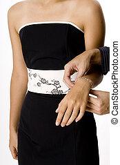 Bracelet - A man fastens a bracelet around a woman\\\'s...