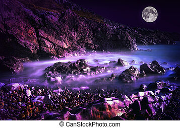 Bracelet Bay with a long exposure at night with a full moon at the Mumbles on the Gower Peninsular West Glamorgan Wales