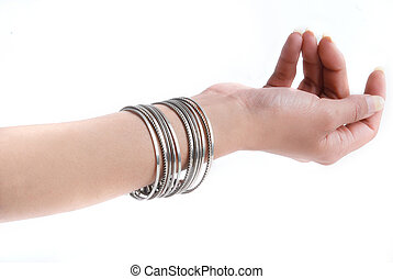 Bracelet on a woman hand isolated on a white background.
