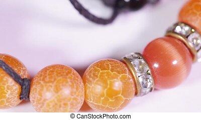 Bracelet - Female handmade bracelet rotates on white...