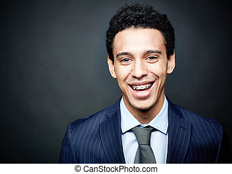 Braces smile - Portrait of a businessman wearing braces and ...